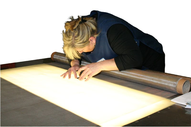 Carefully checking the quality of wire cloth on the roll